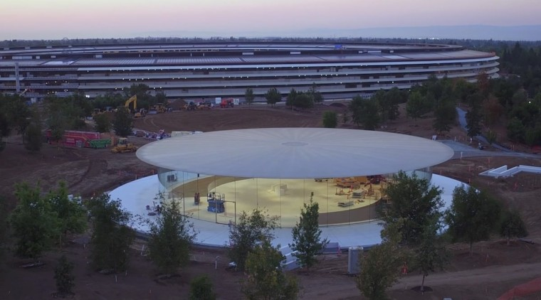 The new Steve Jobs Theater sits beneath the structure, water, water resources, black, blue