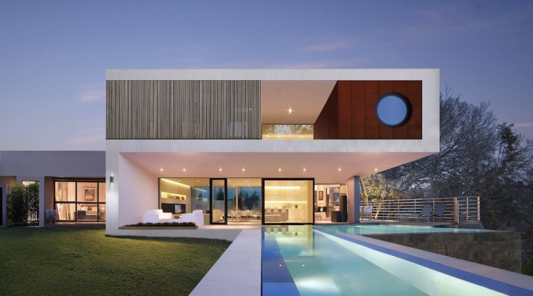This mansion features an expansive lap pool architecture, elevation, estate, facade, home, house, property, real estate, residential area, villa, blue, gray