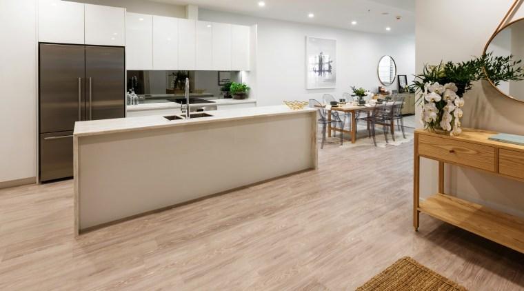 The TIDA NZ Architect-designed apartment winner – Paul floor, flooring, hardwood, interior design, kitchen, laminate flooring, tile, wood, wood flooring, gray