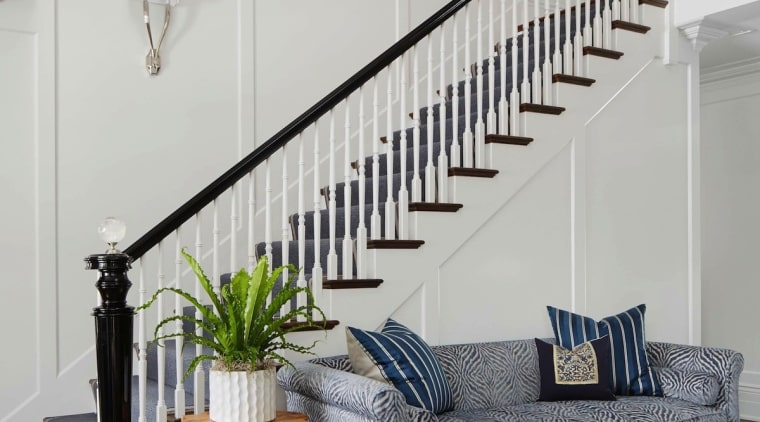 The grand staircase baluster, bed frame, floor, handrail, home, interior design, living room, stairs, wall, gray
