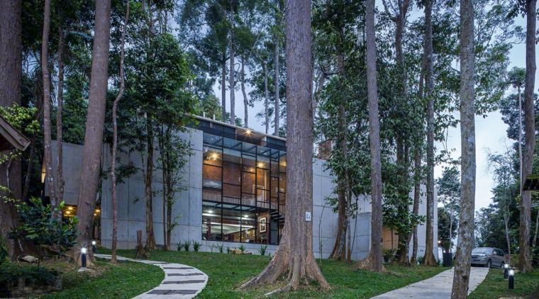 The raw, fair-face concrete wall experienced on the architecture, condominium, cottage, home, house, mixed use, neighbourhood, plant, real estate, residential area, tree, black