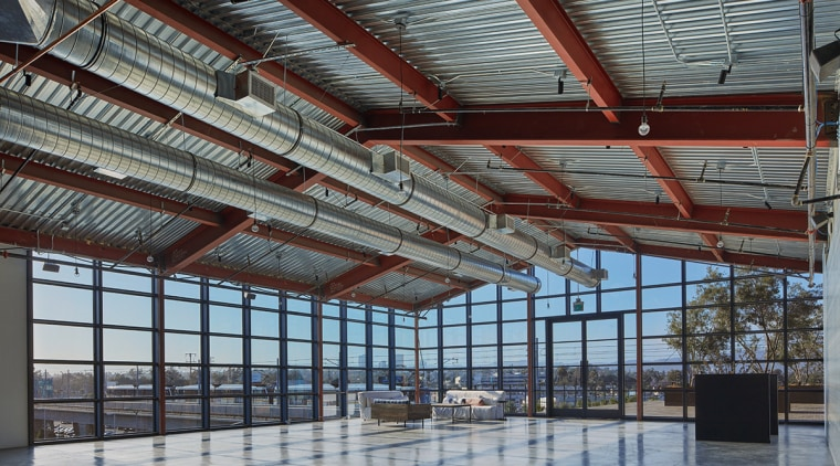 The Greenhouse restaurant and event space continues the beam, daylighting, roof, steel, structure, gray