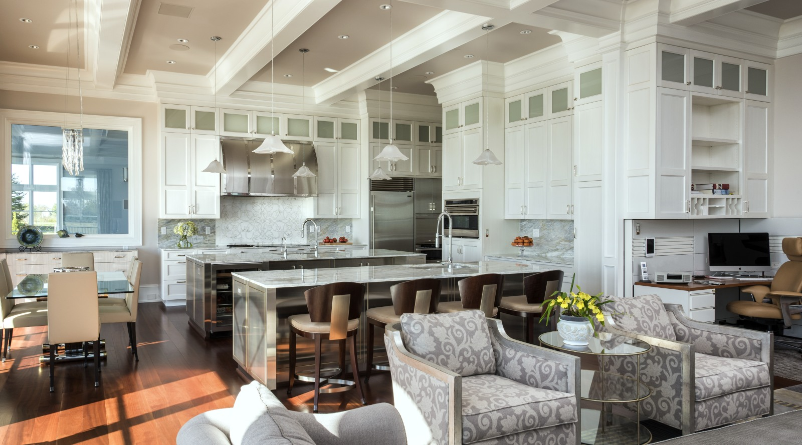 Transitional kitchen with two islands and reflective…