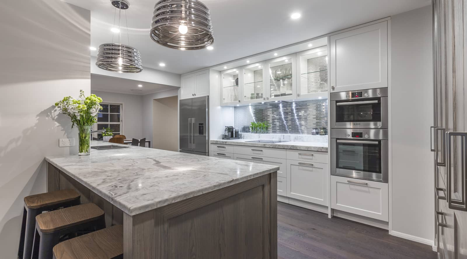 Eclectic kitchen with traditional doors and modern metal…