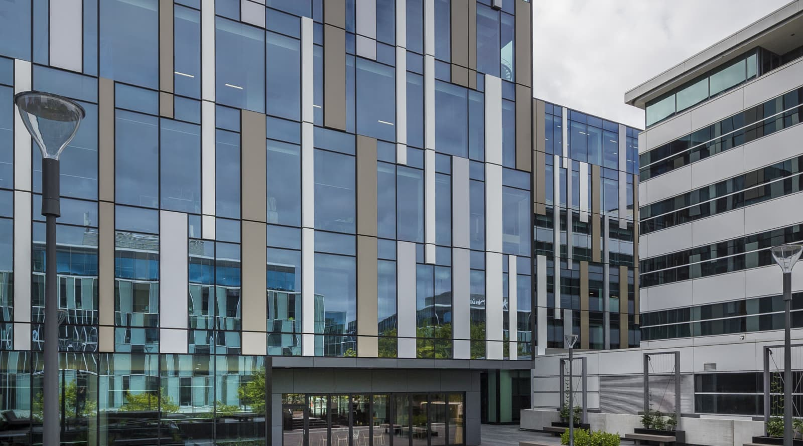 Contemporary mixed-use building complex with linking glass…