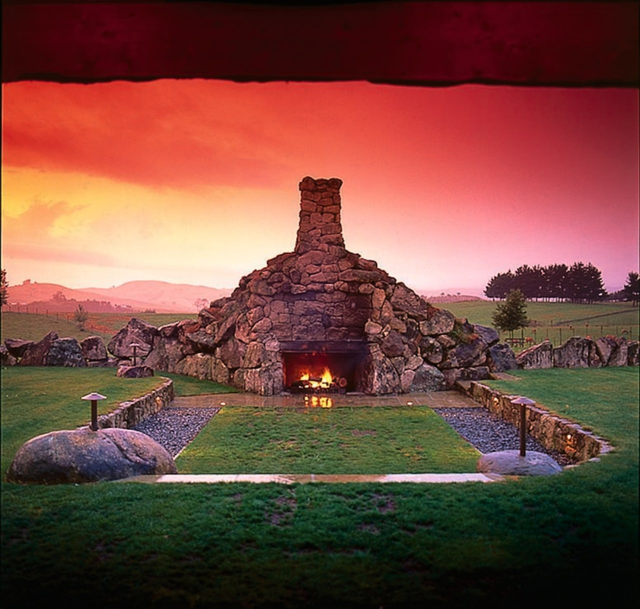 Outdoor fireplace made from stone, set in lawn archaeological site, dawn, evening, grass, historic site, landscape, nature, sky, red