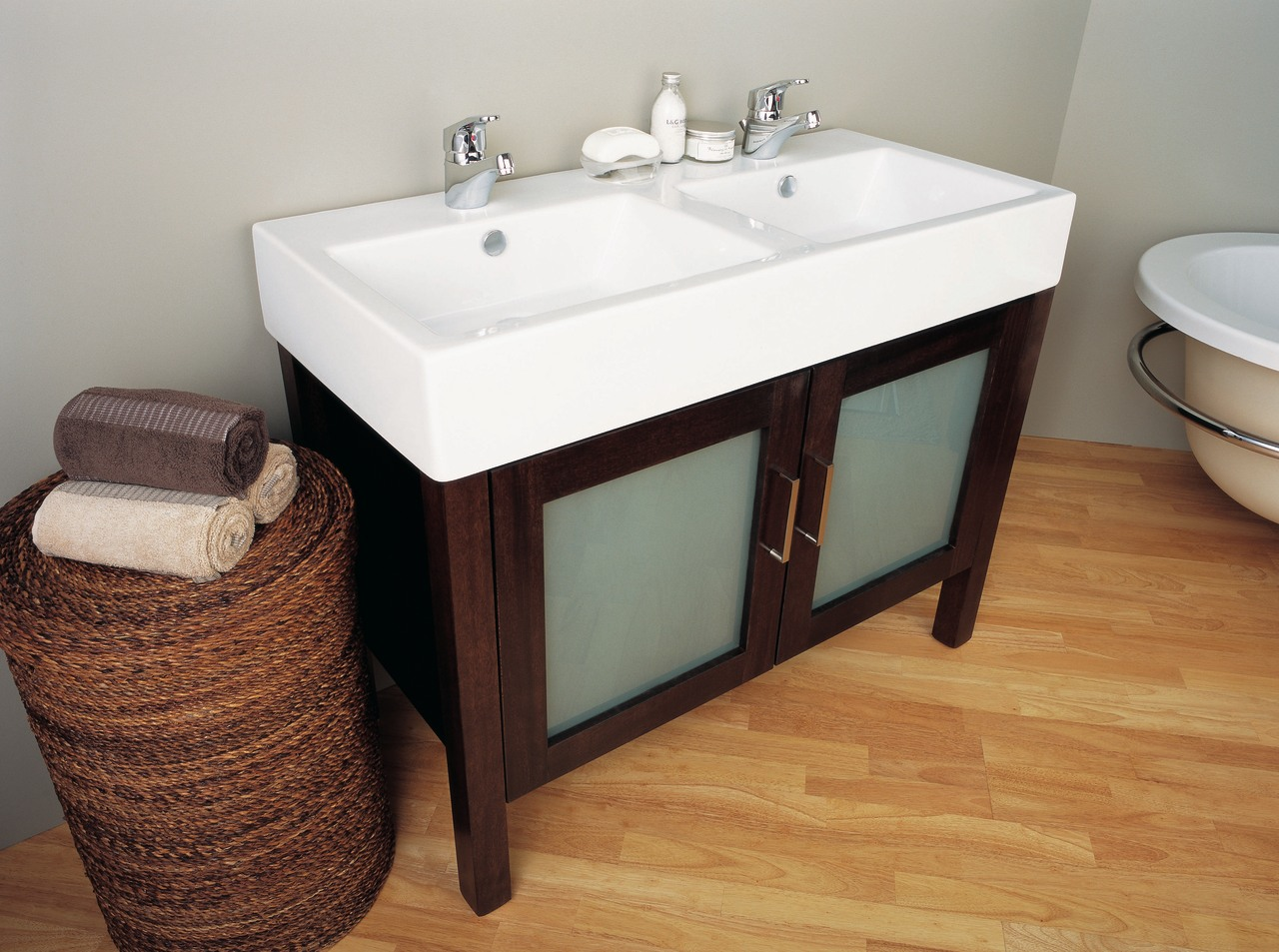The detail of a dual basin bathroom, bathroom accessory, bathroom cabinet, bathroom sink, floor, flooring, furniture, hardwood, plumbing fixture, product, product design, room, sink, white