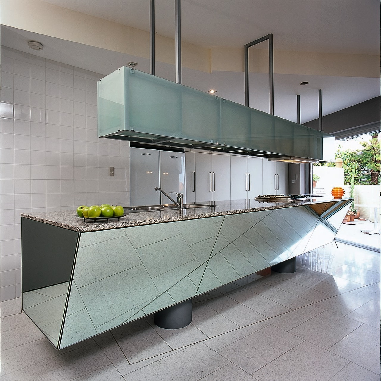 Rhomboid-shaped, mirror-clad island in this kitchen architecture, countertop, interior design, kitchen, product design, gray