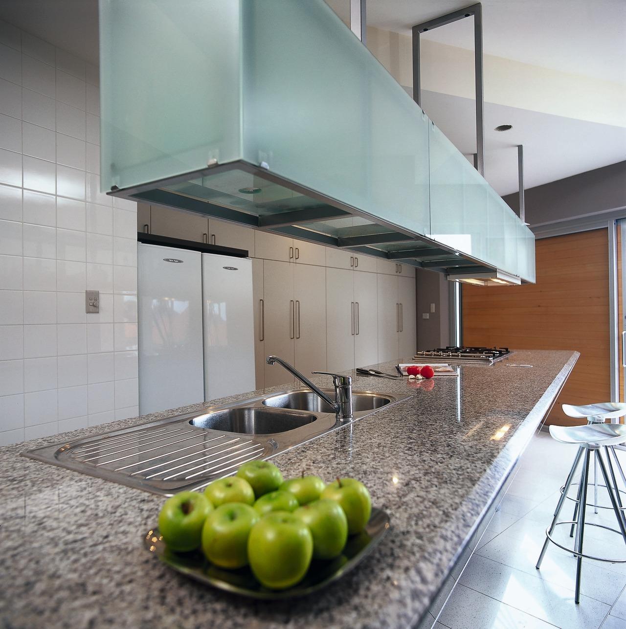 A granite benchtop under a glass storage unit architecture, countertop, house, interior design, kitchen, gray