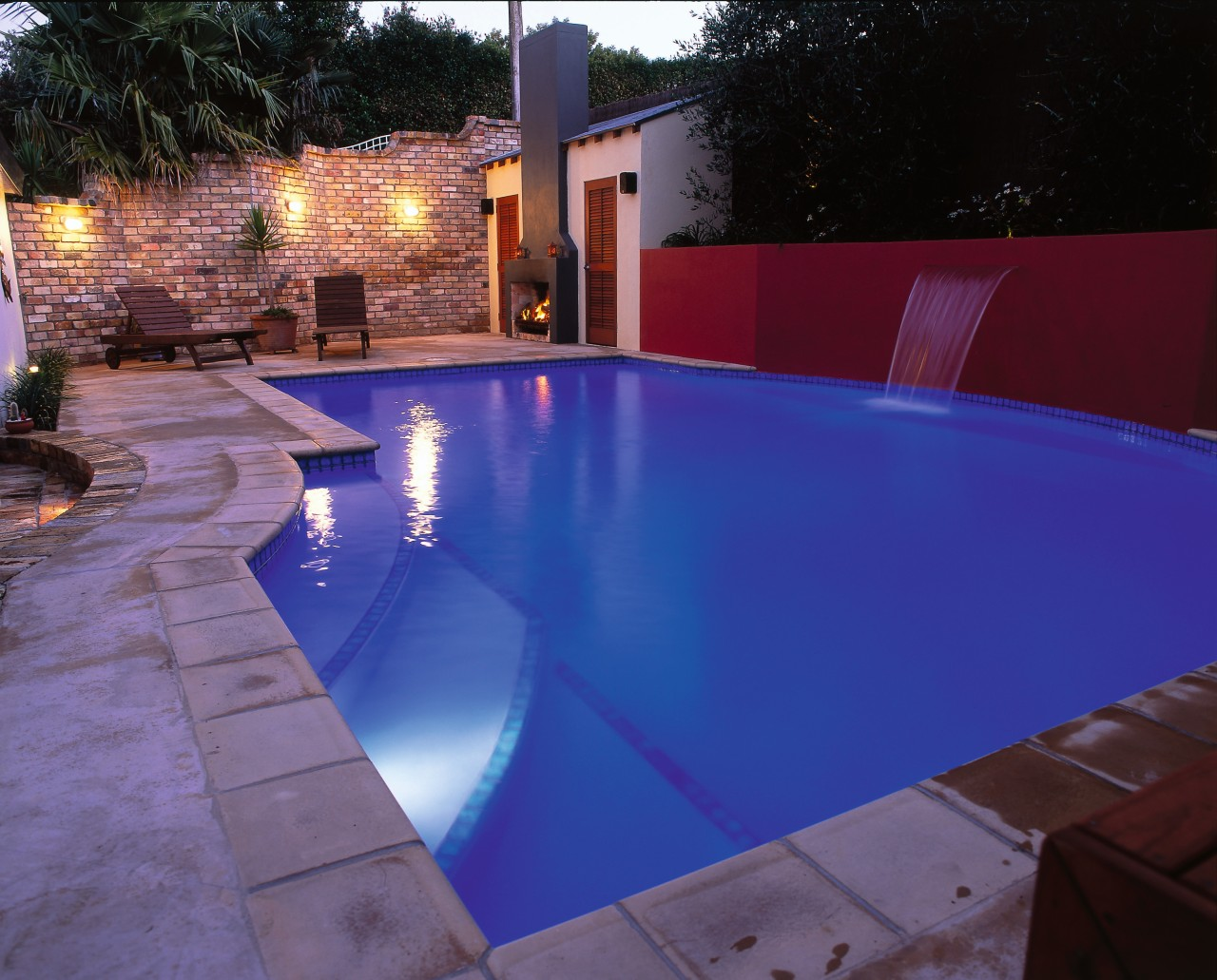 Broad view of the pool backyard, floor, leisure, light, lighting, property, real estate, reflection, swimming pool, water, water feature, blue