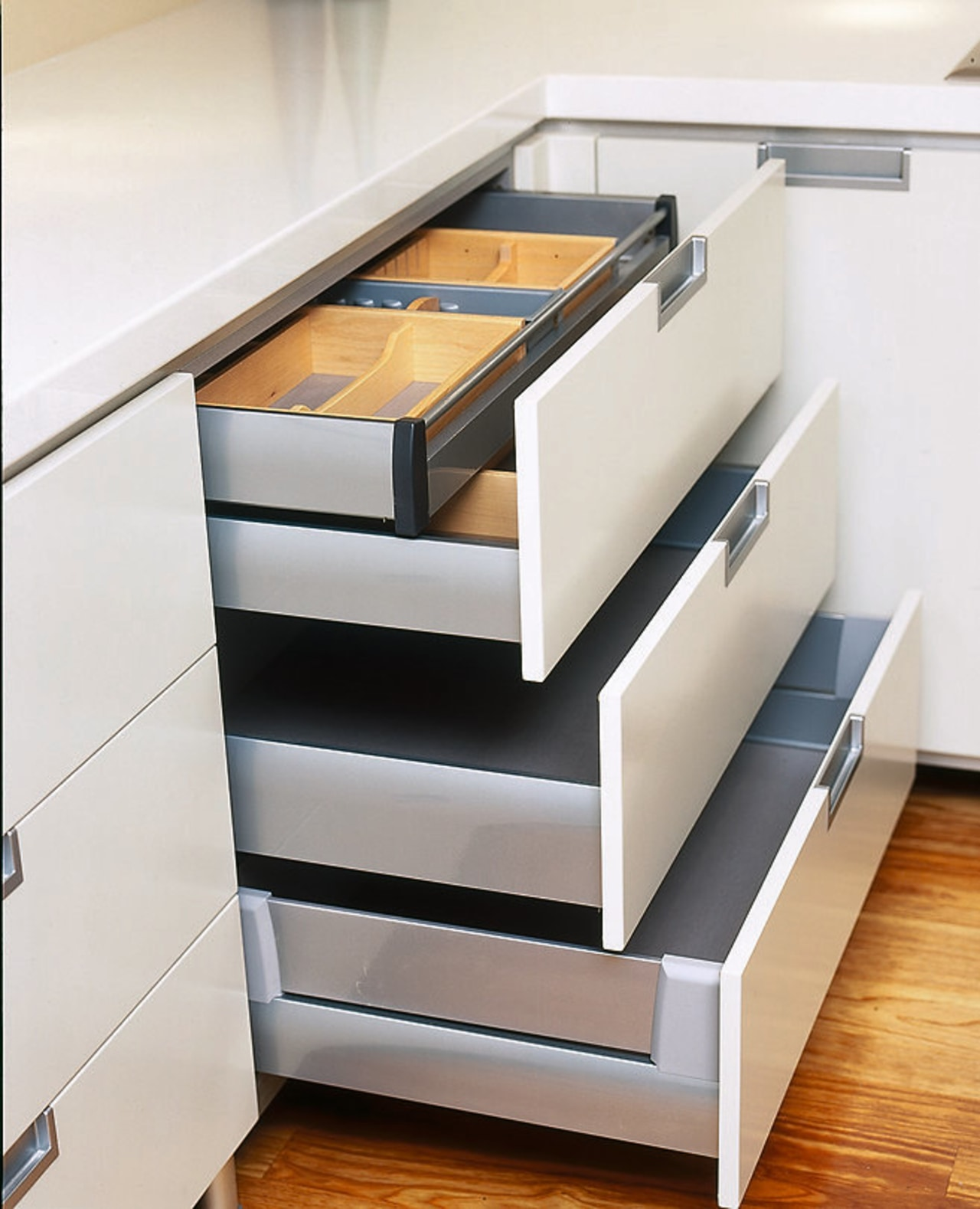 View of the storage cabinetry, chest of drawers, countertop, drawer, floor, furniture, kitchen, product, product design, shelf, stairs, white