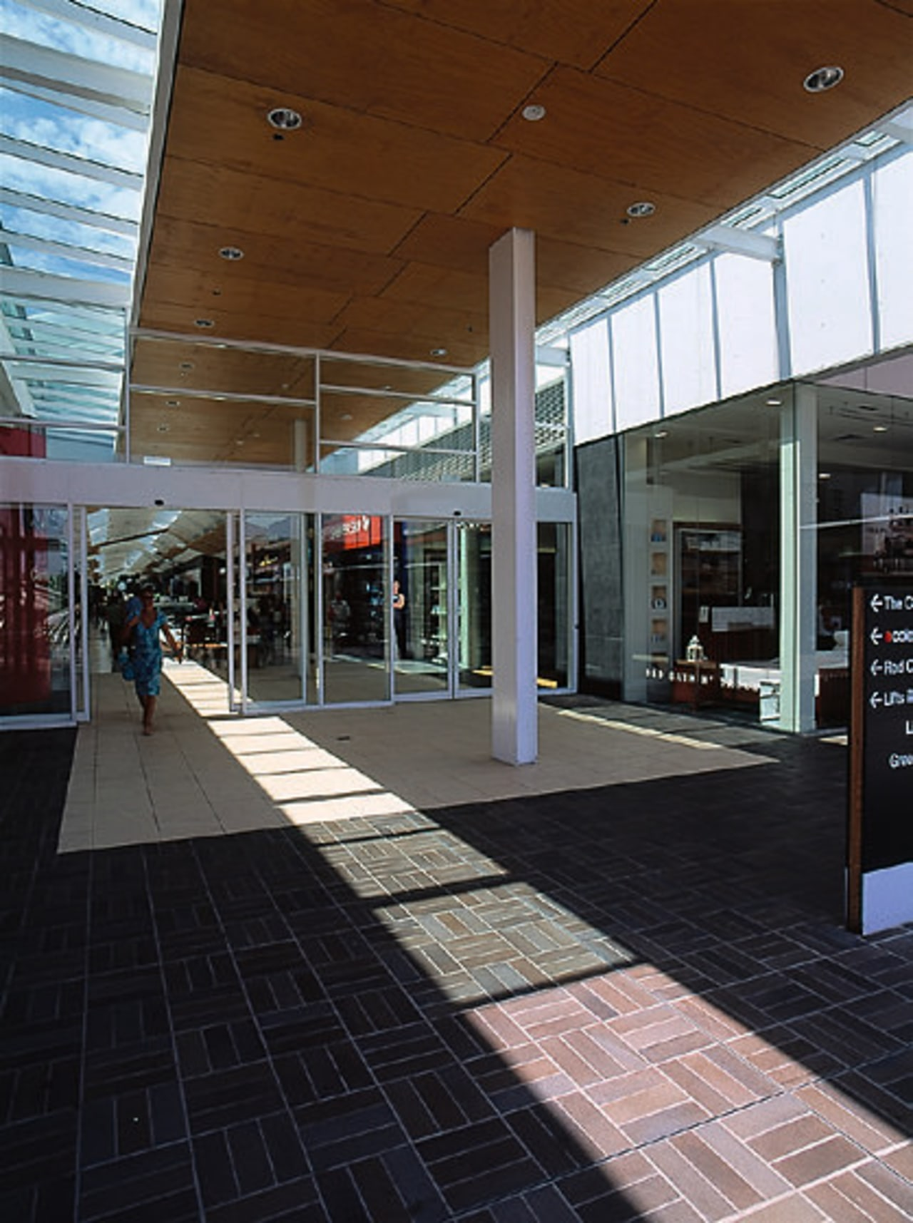 View of entrance to shopping centre in New architecture, building, metropolitan area, shopping mall, black, gray