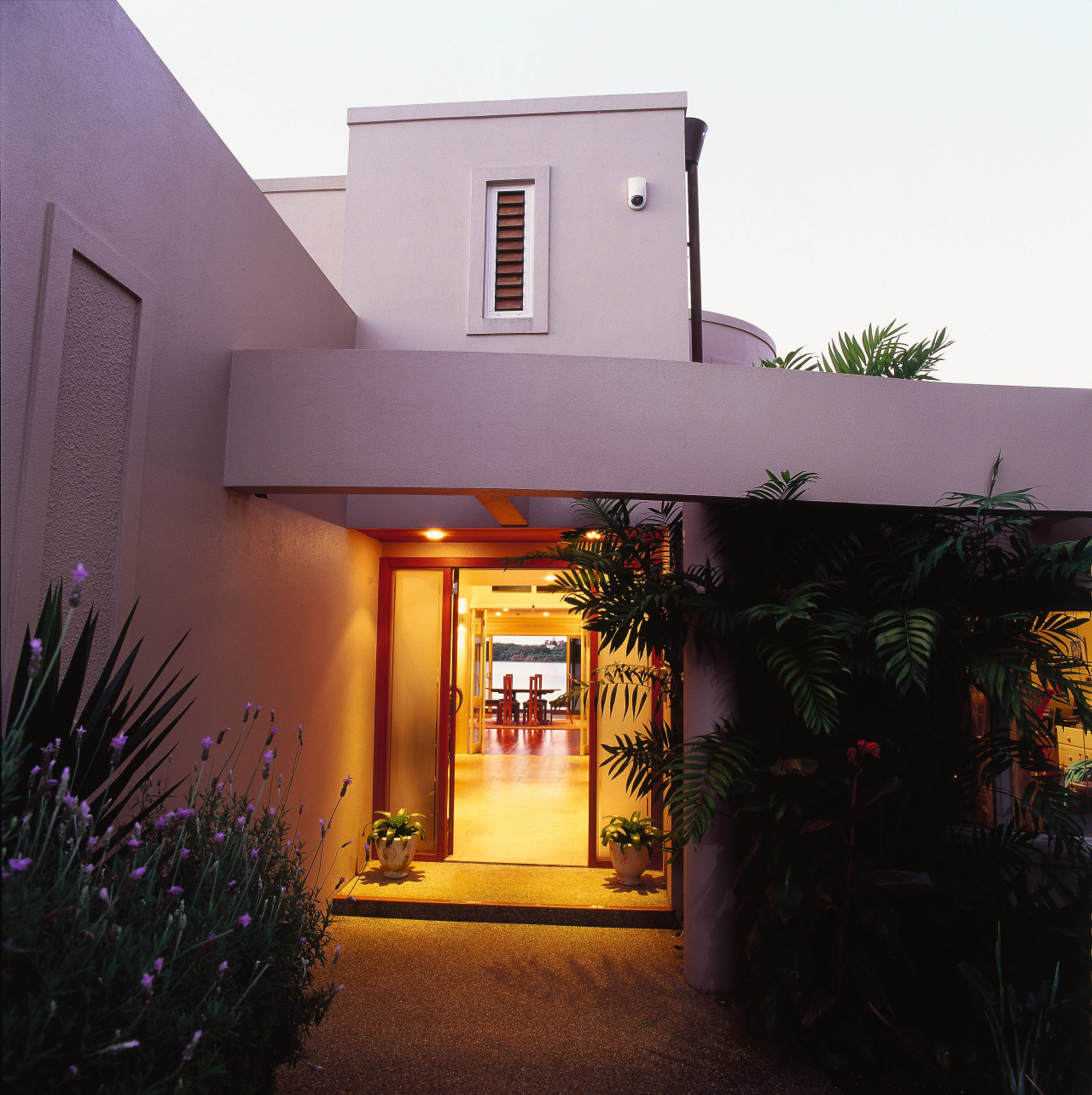 Entranceway to house with bright-lit formal look, and architecture, building, estate, facade, hacienda, home, house, lighting, property, real estate, black