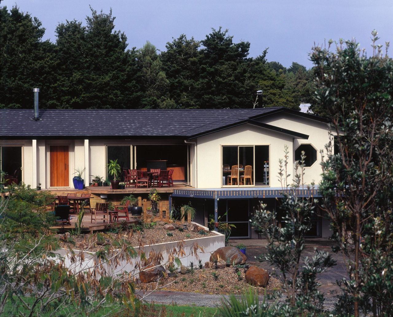 Contemporary country house with black shingle roofing, cream cottage, facade, home, house, landscape, outdoor structure, property, real estate, roof, siding, black