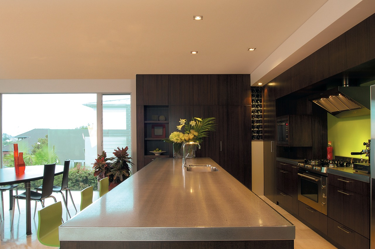 The view of a kitchen with a lime architecture, countertop, dining room, house, interior design, kitchen, real estate, room, black, orange