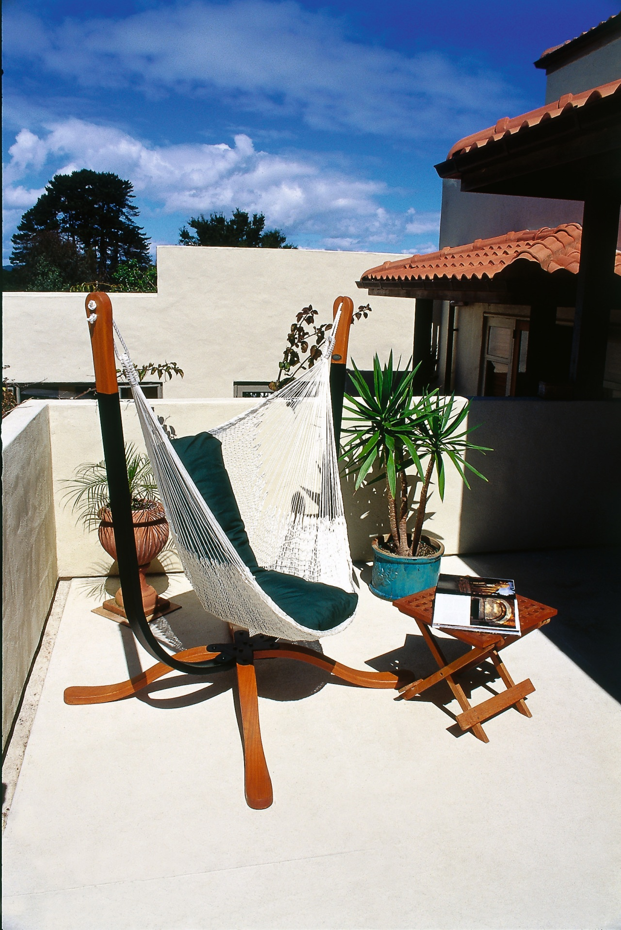 View of this hammock chair, furniture, house, leisure, outdoor furniture, sunlounger, table, vacation, water, white
