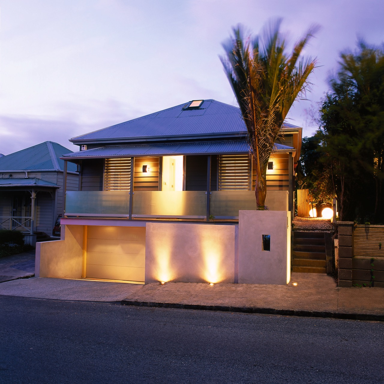 Exterior of house showing road frontage with lights architecture, building, cottage, elevation, estate, evening, facade, home, house, lighting, property, real estate, residential area, roof, siding, suburb, window, blue, purple