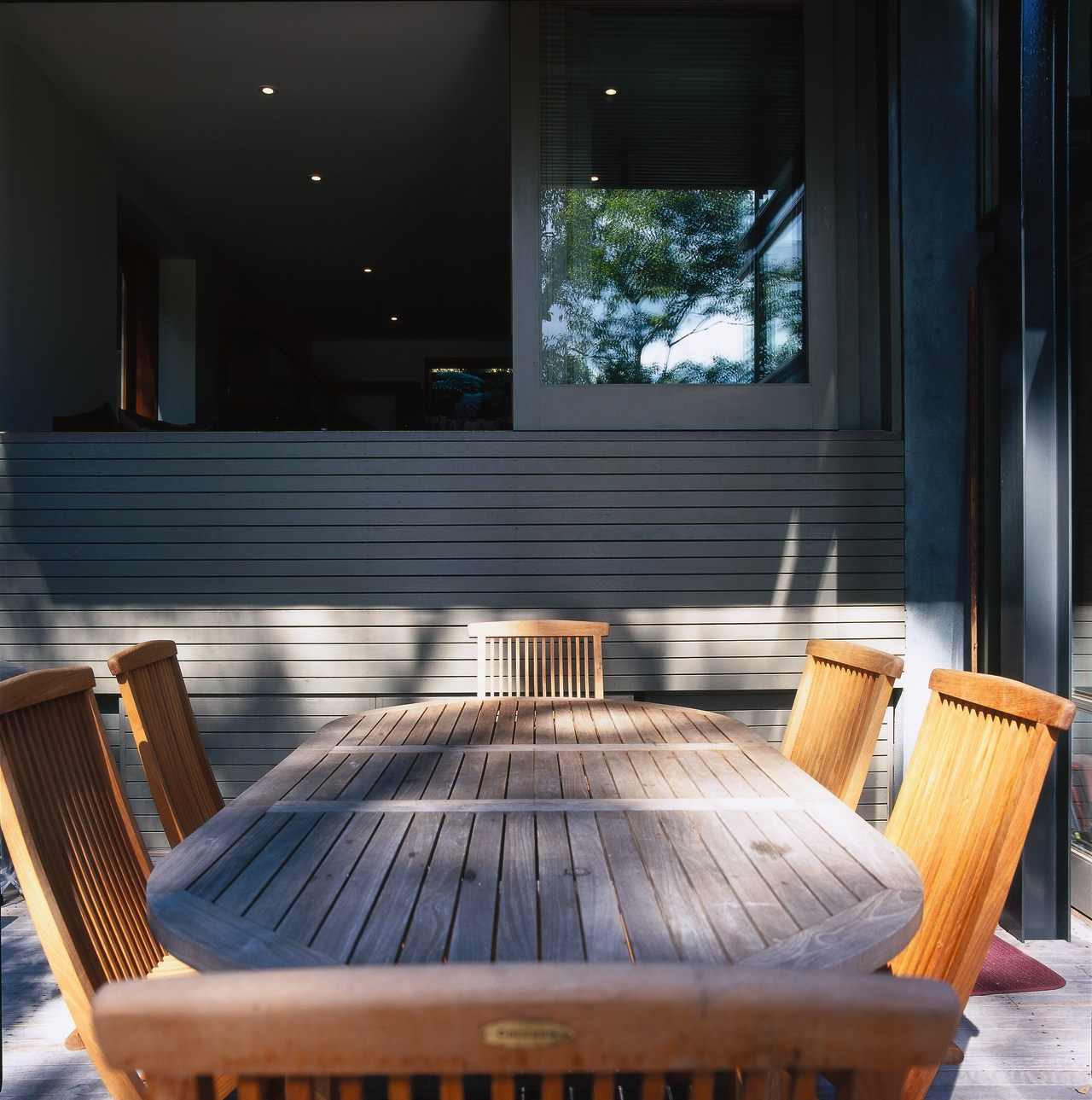 Wooden outdoor dining table and chairs on patio, architecture, chair, daylighting, floor, furniture, hardwood, interior design, lighting, outdoor furniture, table, wood, black