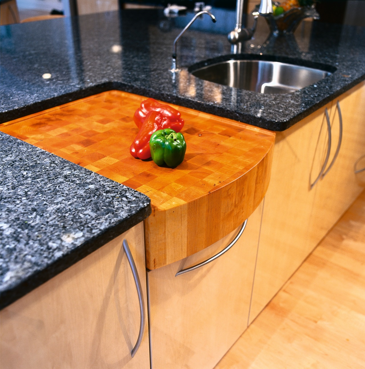 Close view of the built-in chopping board countertop, floor, flooring, furniture, hardwood, material, table, wood, wood stain, orange