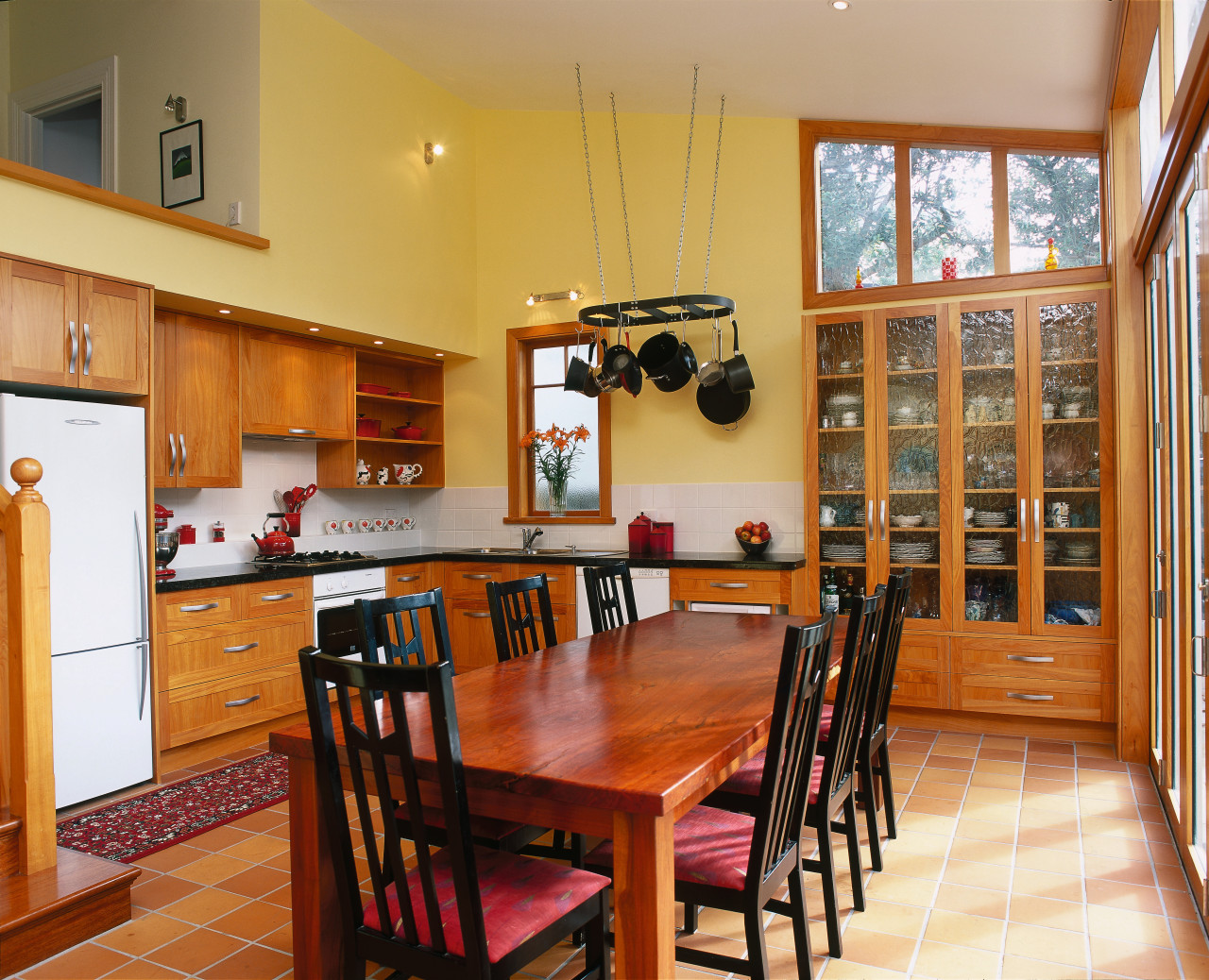 Traditional kitchen with macrocarpa cabinetry, glass doors in dining room, flooring, hardwood, interior design, kitchen, property, real estate, room, table, wood, orange, brown