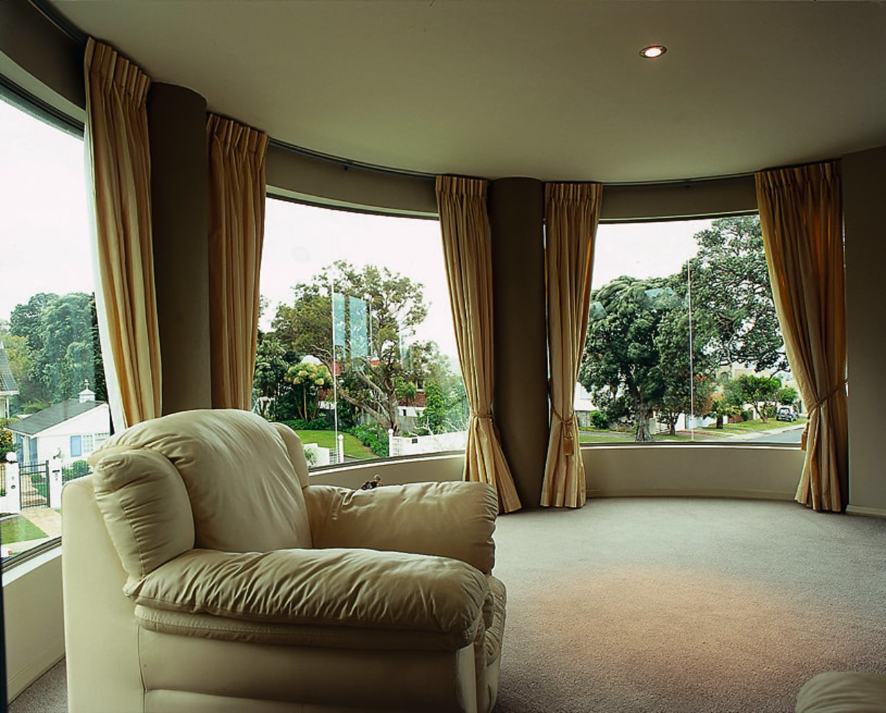 View of curved glass from the living room ceiling, curtain, estate, home, house, interior design, living room, property, real estate, room, window, window covering, window treatment, brown