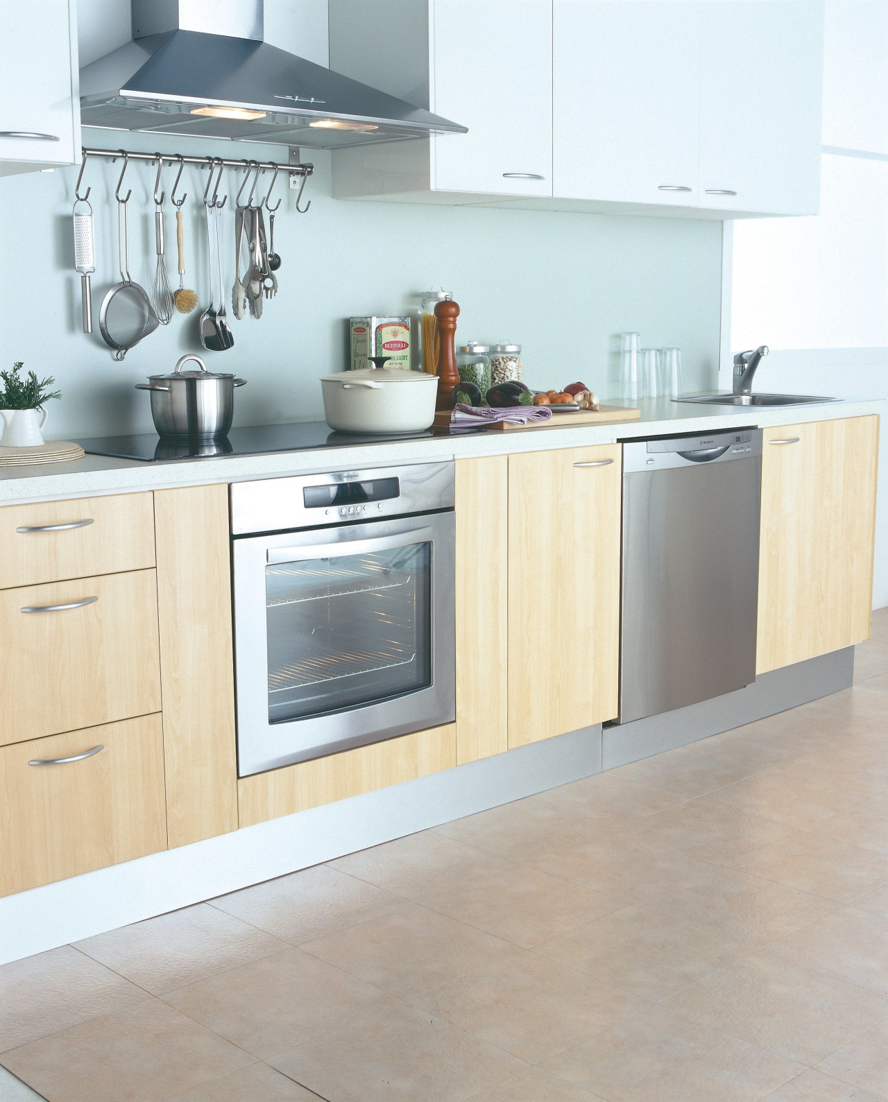 A photograph of a kitchen featuring Westinghouse kitchen cabinetry, countertop, cuisine classique, floor, flooring, furniture, home appliance, interior design, kitchen, kitchen appliance, kitchen stove, major appliance, product design, gray, white