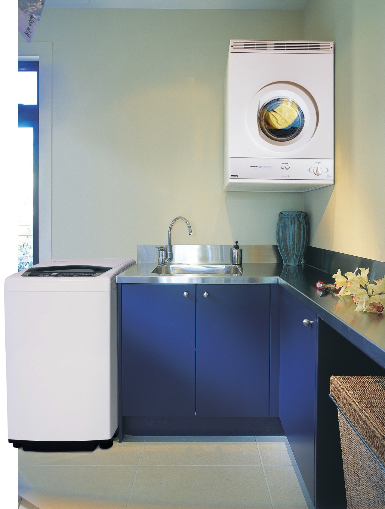 A laundry featuring a Smeg washing machine and bathroom, clothes dryer, home appliance, kitchen, laundry, laundry room, major appliance, product, product design, room, sink, washing machine, gray