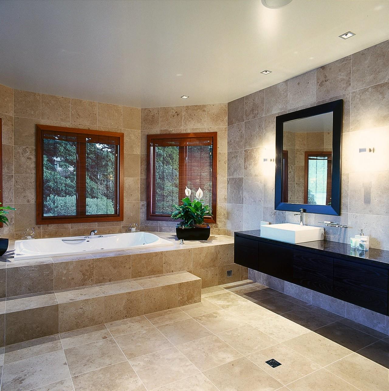 View of the spacious and fully tiled bathroom. bathroom, ceiling, estate, floor, flooring, home, interior design, lobby, property, real estate, room, tile, wall, window, wood flooring, orange, gray