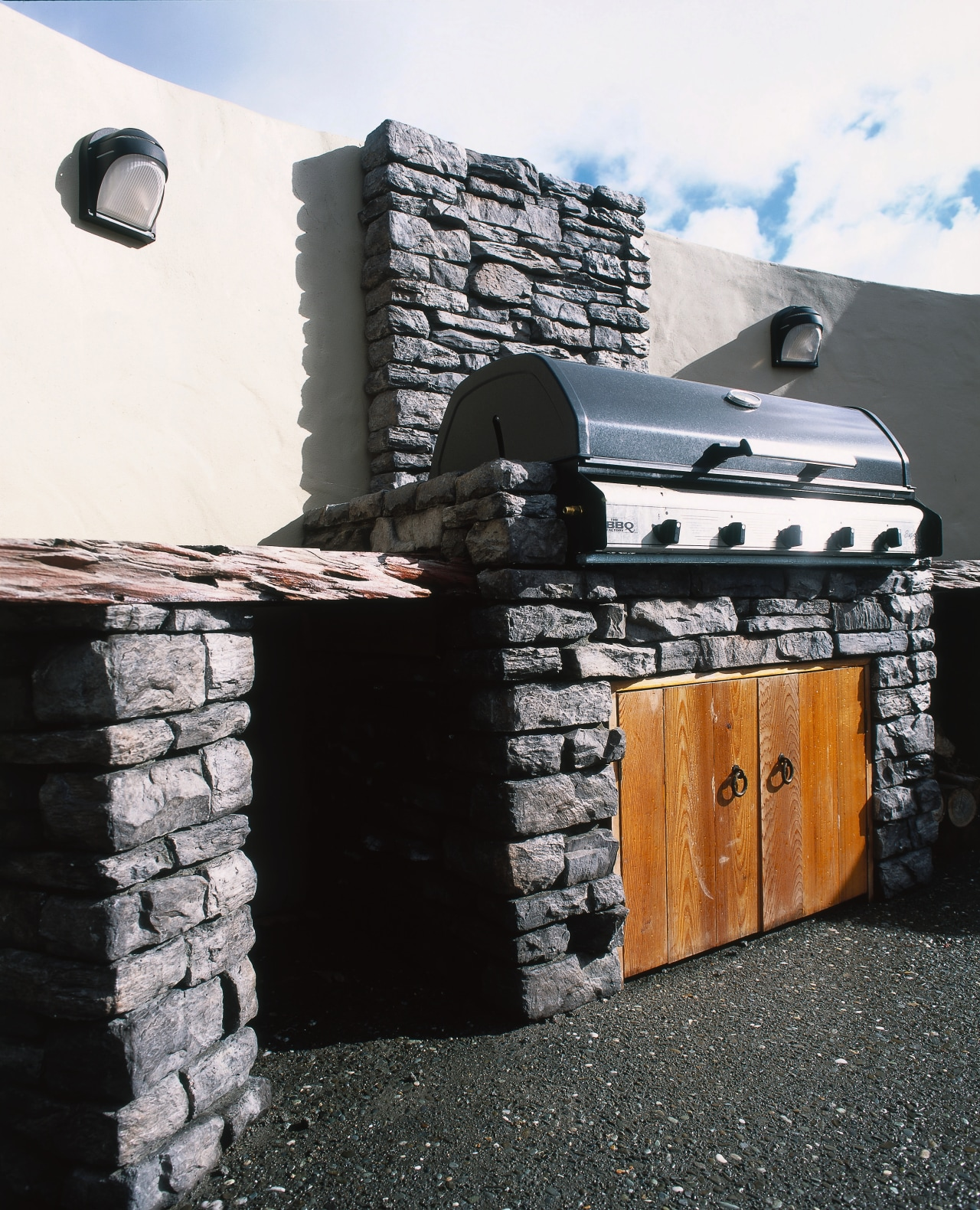 Barbeque with stone surround and timber doors below, chimney, roof, wall, black, white