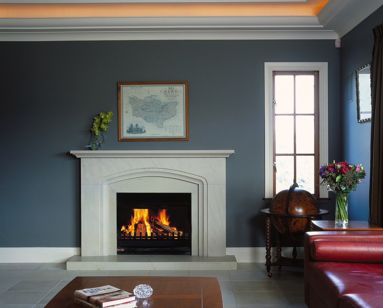 View of this lounge area fireplace, hearth, home, home appliance, interior design, living room, wood burning stove, black, gray