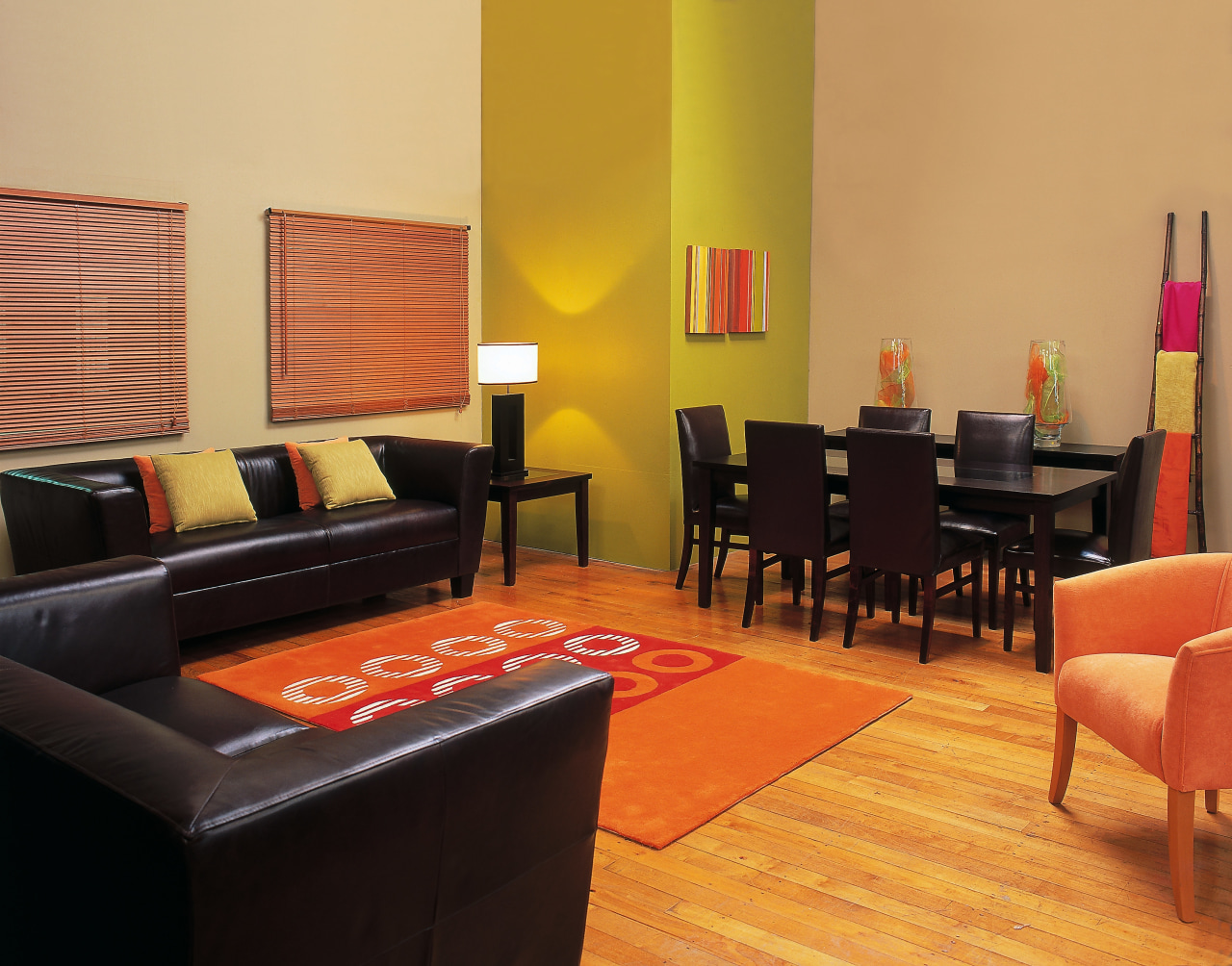 Interior view of lounge area floor, flooring, furniture, interior design, living room, room, suite, table, orange, black