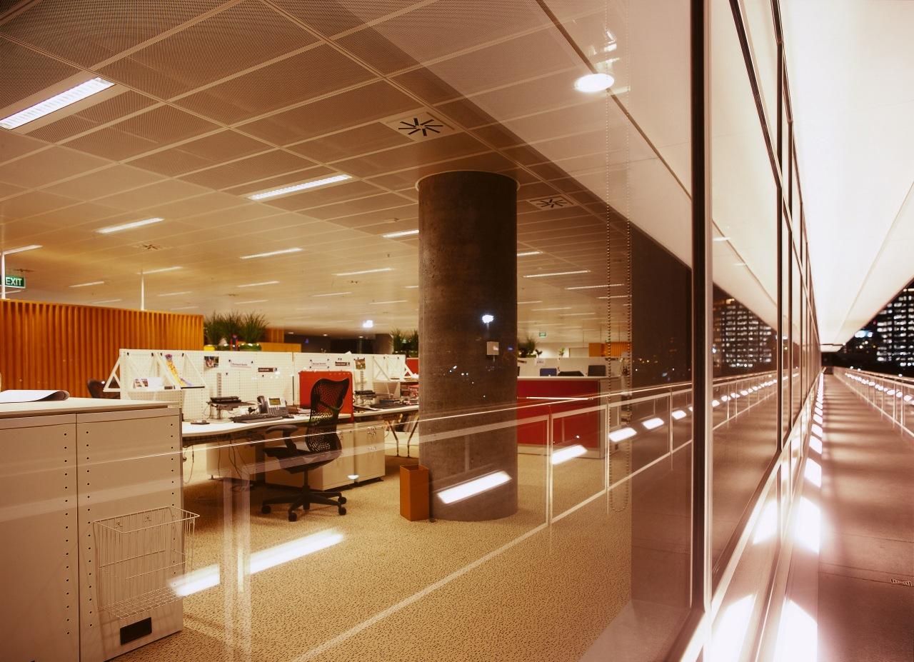 Open plan office floor with Herman Miller office architecture, ceiling, floor, flooring, interior design, lobby, wood, brown, orange