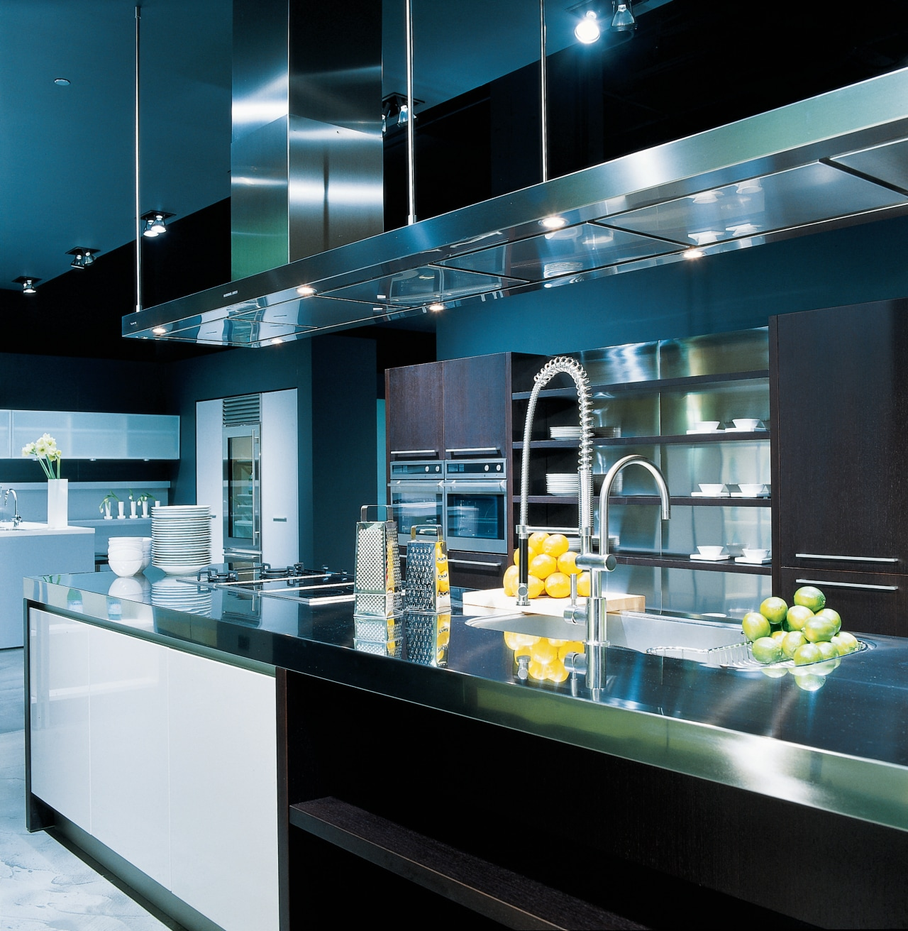 View of a contemporary kitchen involving many stainless countertop, glass, interior design, kitchen, black, teal
