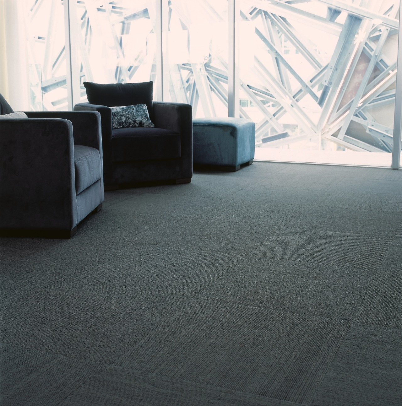 Grey carpet with grey armchairs and steel beams angle, carpet, chair, floor, flooring, furniture, hardwood, interior design, laminate flooring, living room, product design, table, tile, wood, wood flooring, black, gray