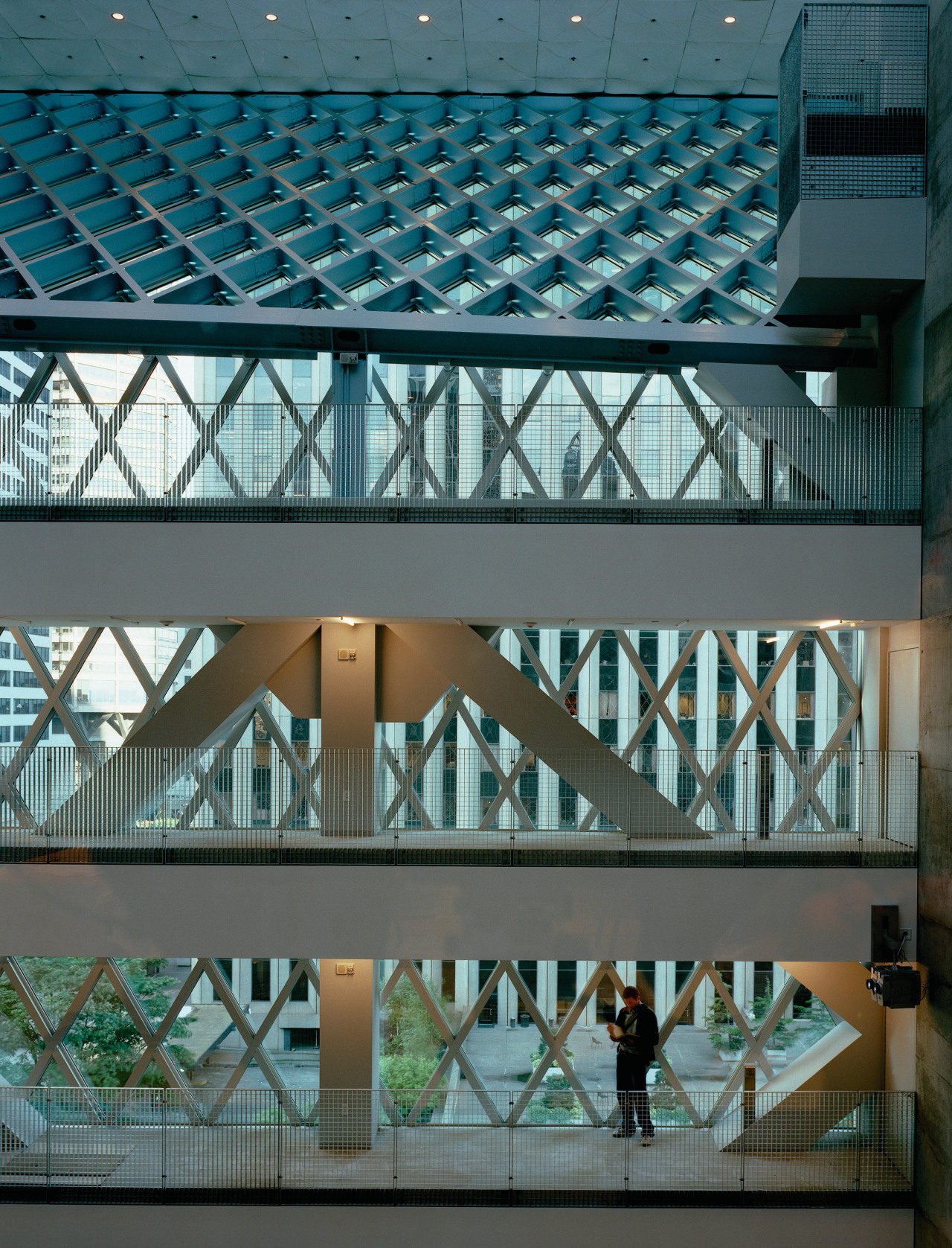 View of all the levels in side of architecture, building, daylighting, daytime, facade, glass, metropolitan area, reflection, structure, tourist attraction, window, teal, gray