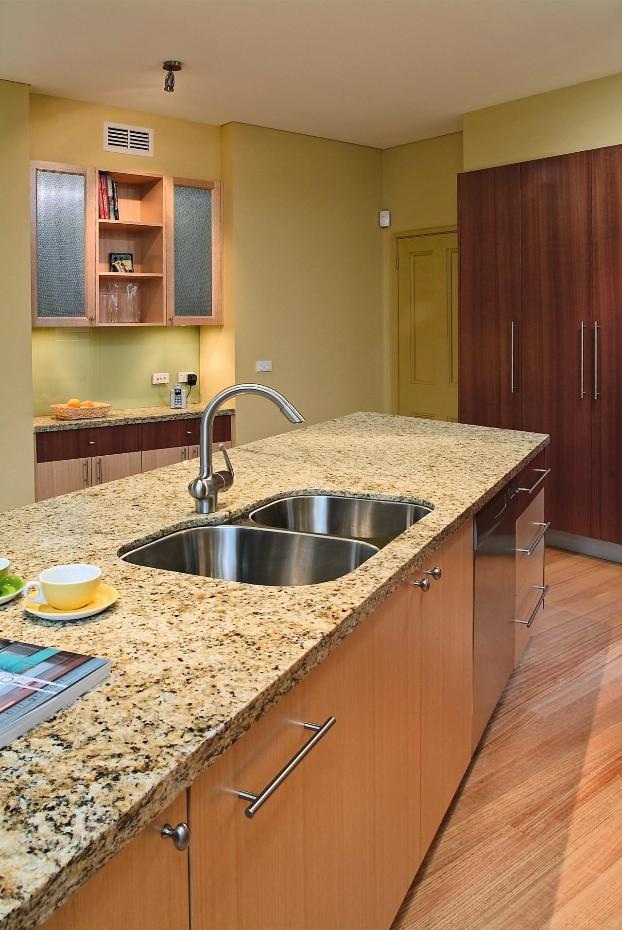 view of the giallo topazio granite benchtop cabinetry, countertop, floor, flooring, hardwood, interior design, kitchen, room, brown, orange