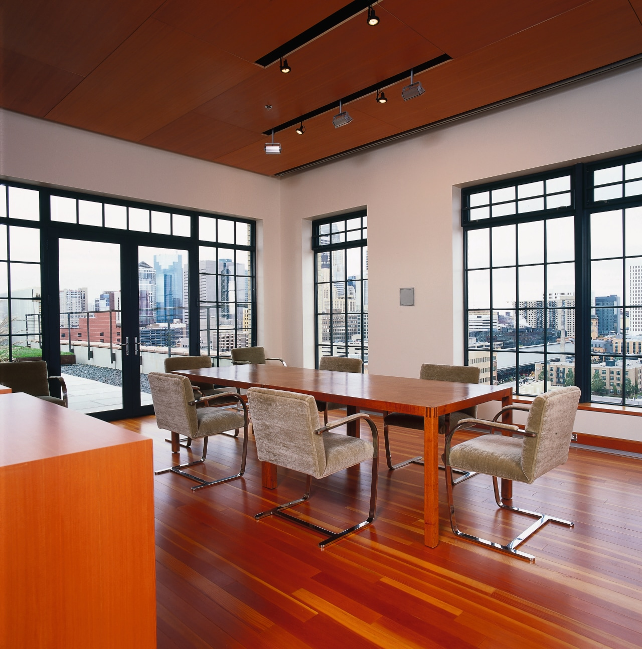 View of the dining room, wooden flooring, ceiling architecture, ceiling, chair, daylighting, floor, flooring, furniture, hardwood, interior design, living room, loft, table, window, wood, wood flooring, red, gray