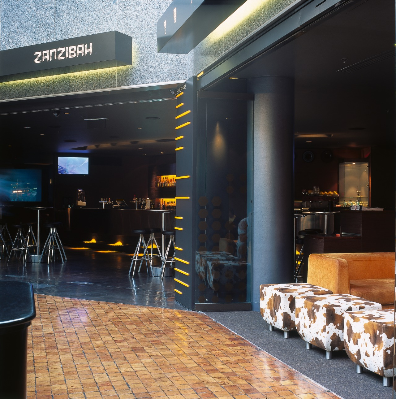 View of a shop and a cafe within interior design, black