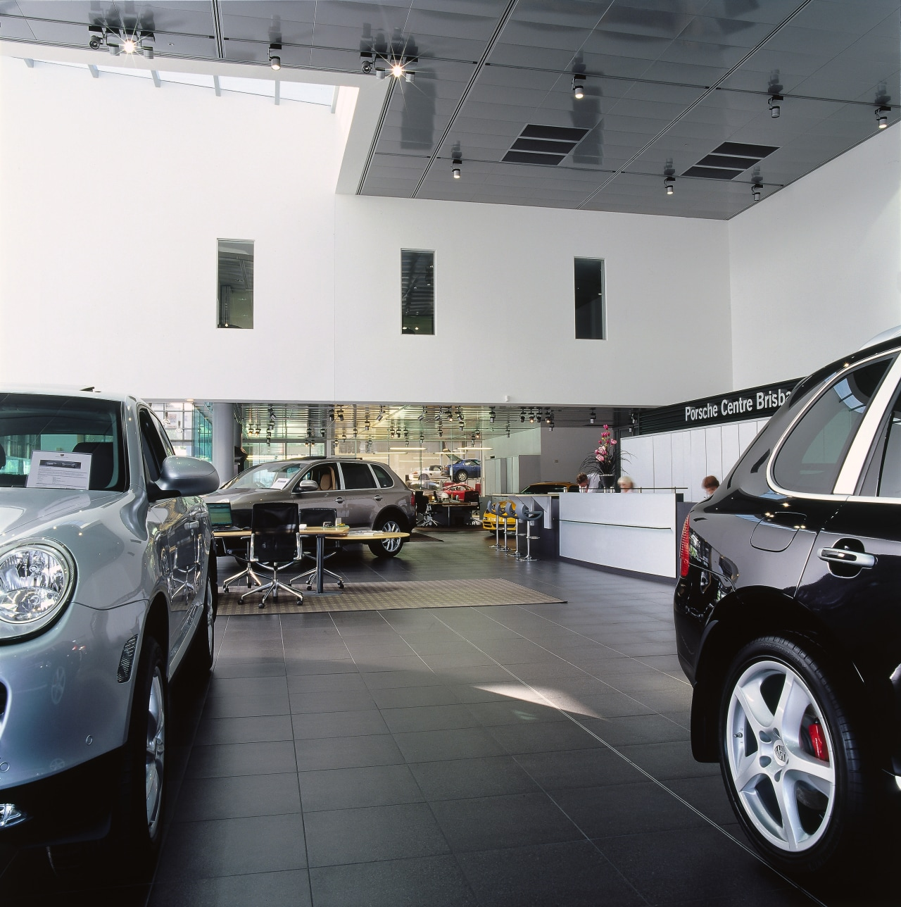 view of the warehouse area automobile repair shop, automotive design, automotive exterior, building, car, car dealership, executive car, family car, luxury vehicle, mid size car, motor vehicle, personal luxury car, sport utility vehicle, technology, vehicle, gray, black