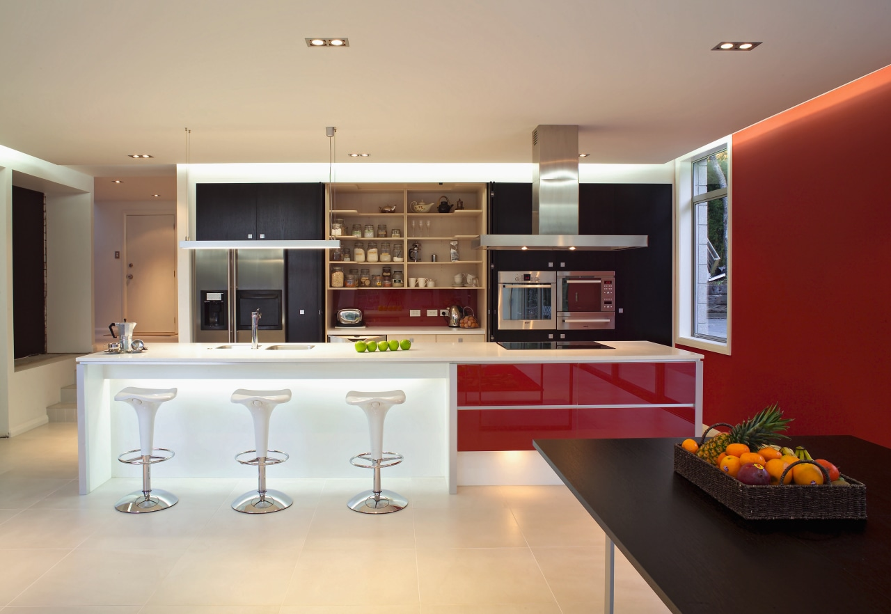 view of this kitchen featuring ameron caprithane coating cabinetry, countertop, cuisine classique, interior design, interior designer, kitchen, living room, real estate, room, orange