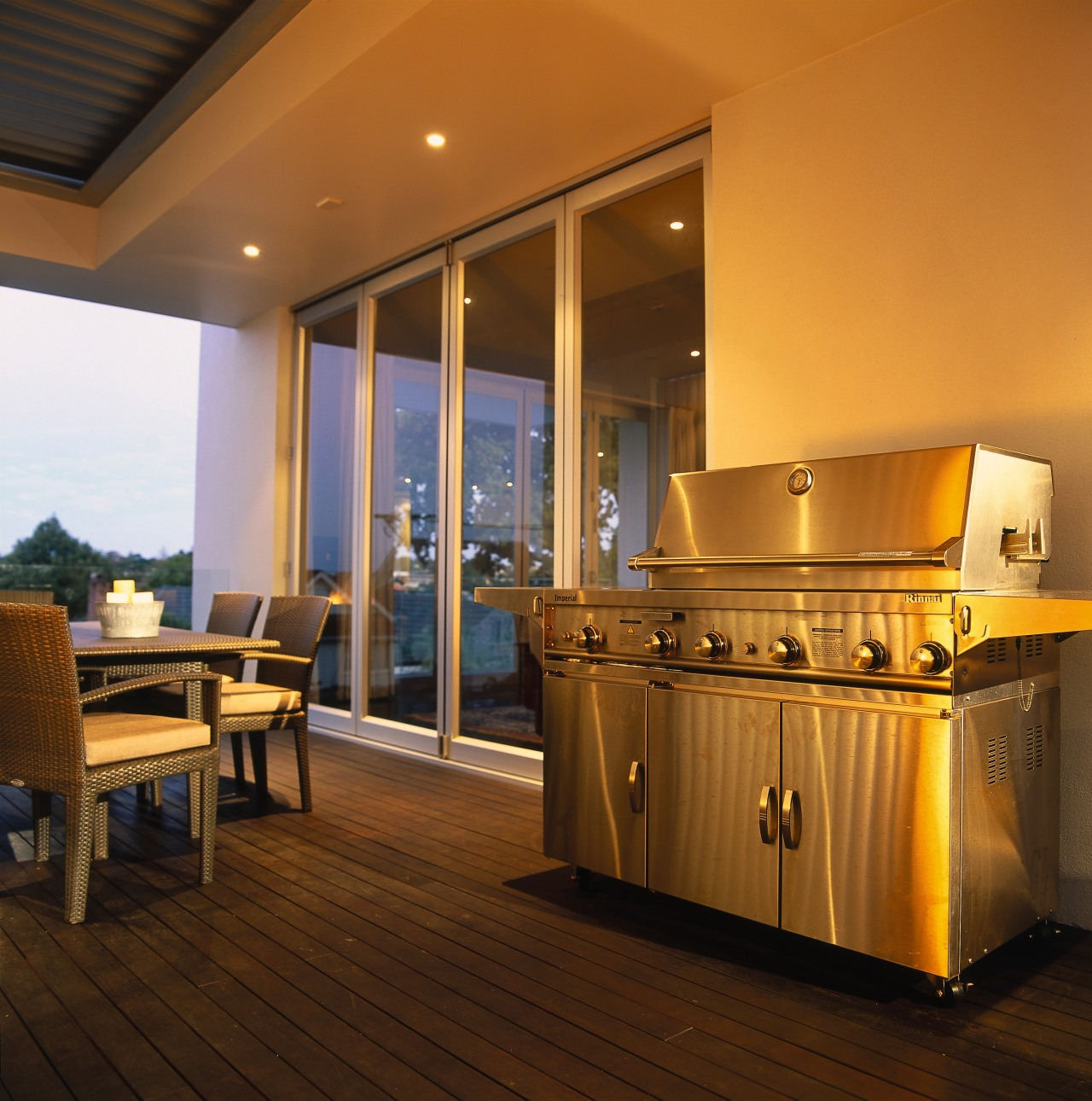 Patio area with large stainless steel barbeque, dining floor, flooring, interior design, lighting, real estate, brown