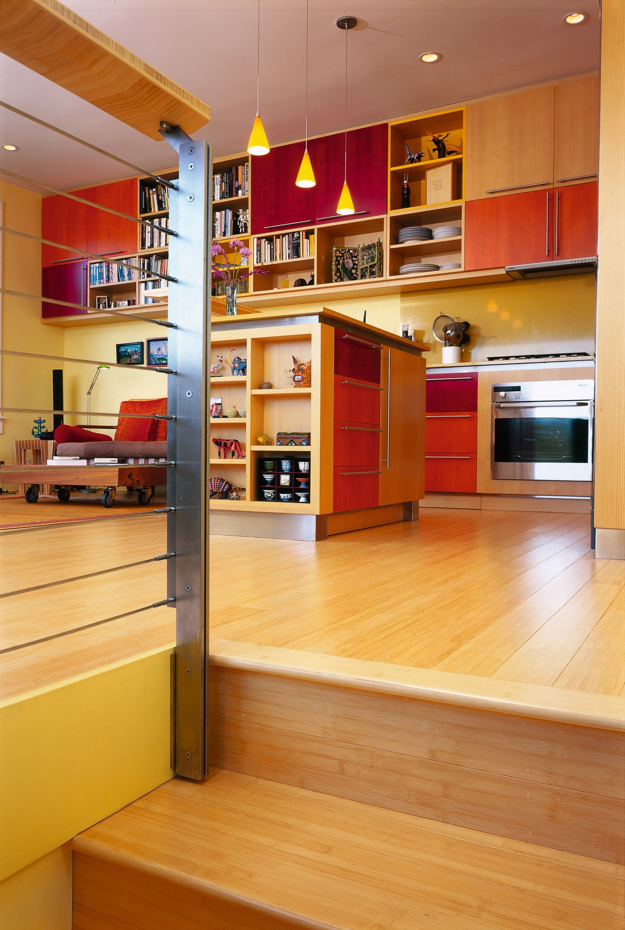 A view of the kitchen area from the bookcase, cabinetry, floor, flooring, furniture, hardwood, interior design, kitchen, shelf, shelving, wood, wood flooring, orange, brown