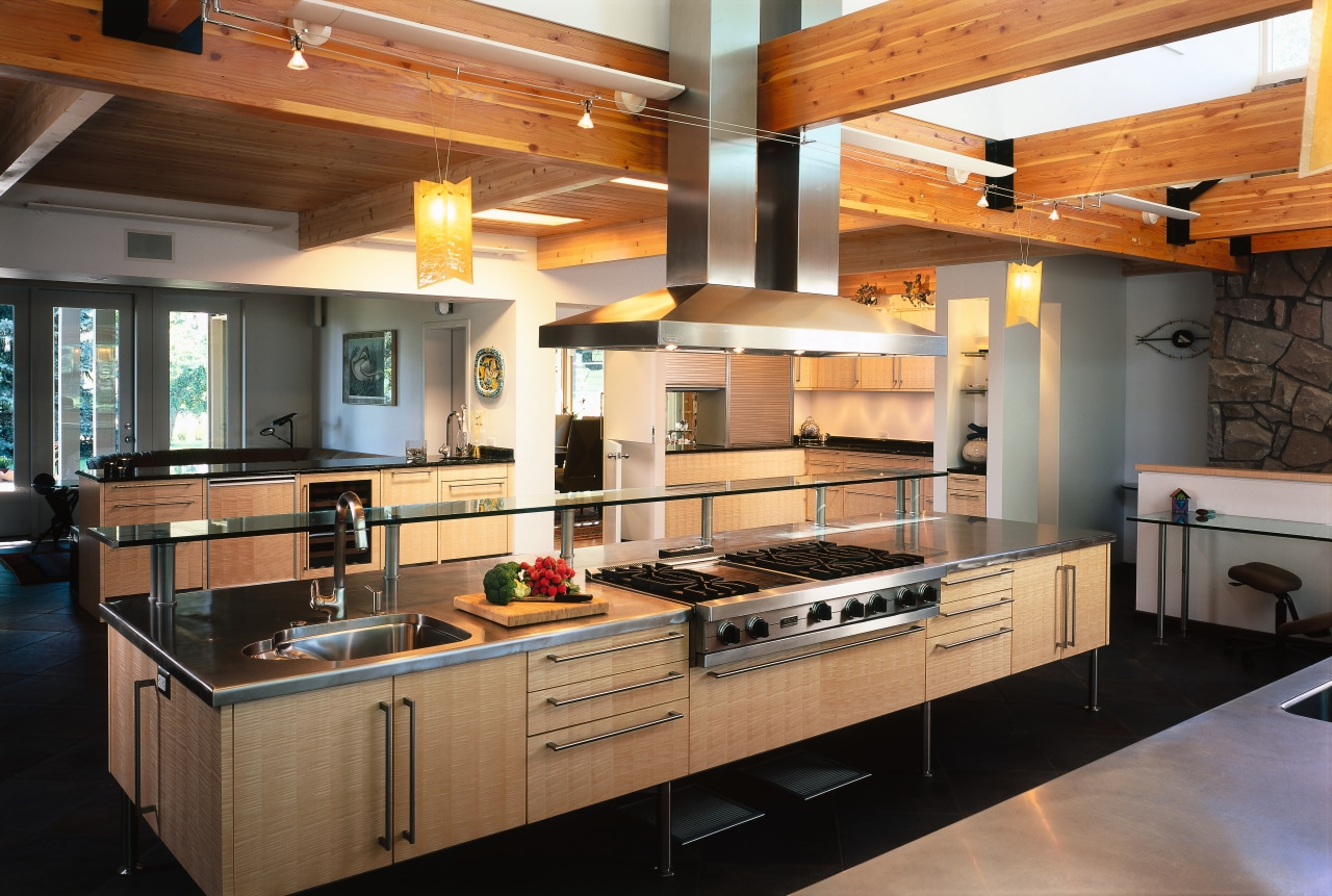 view of the kitchen island showing stainless cooktop countertop, interior design, kitchen, black