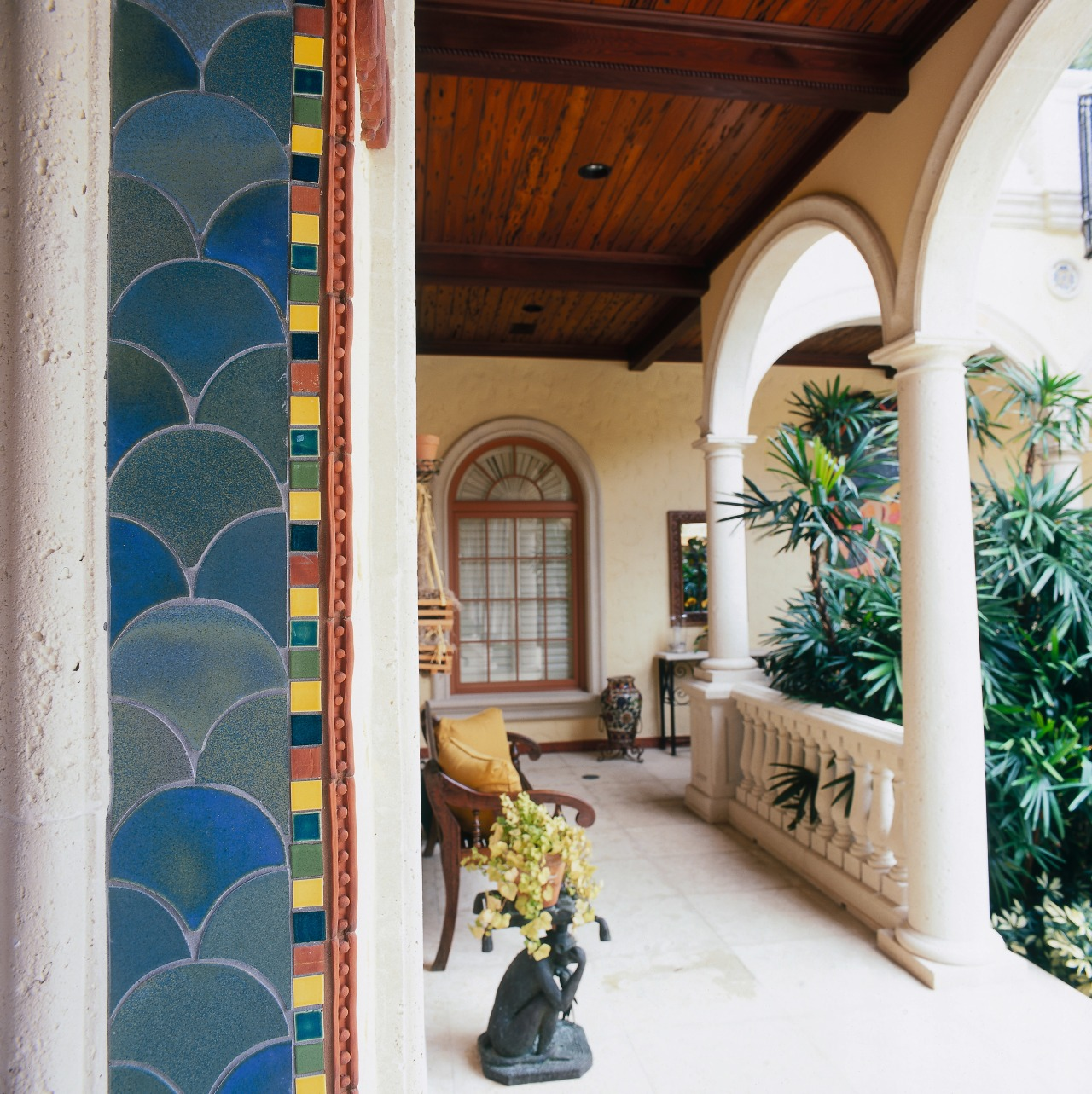 view of the brightly coloured tile edging adds door, estate, home, interior design, real estate, structure, wall, window