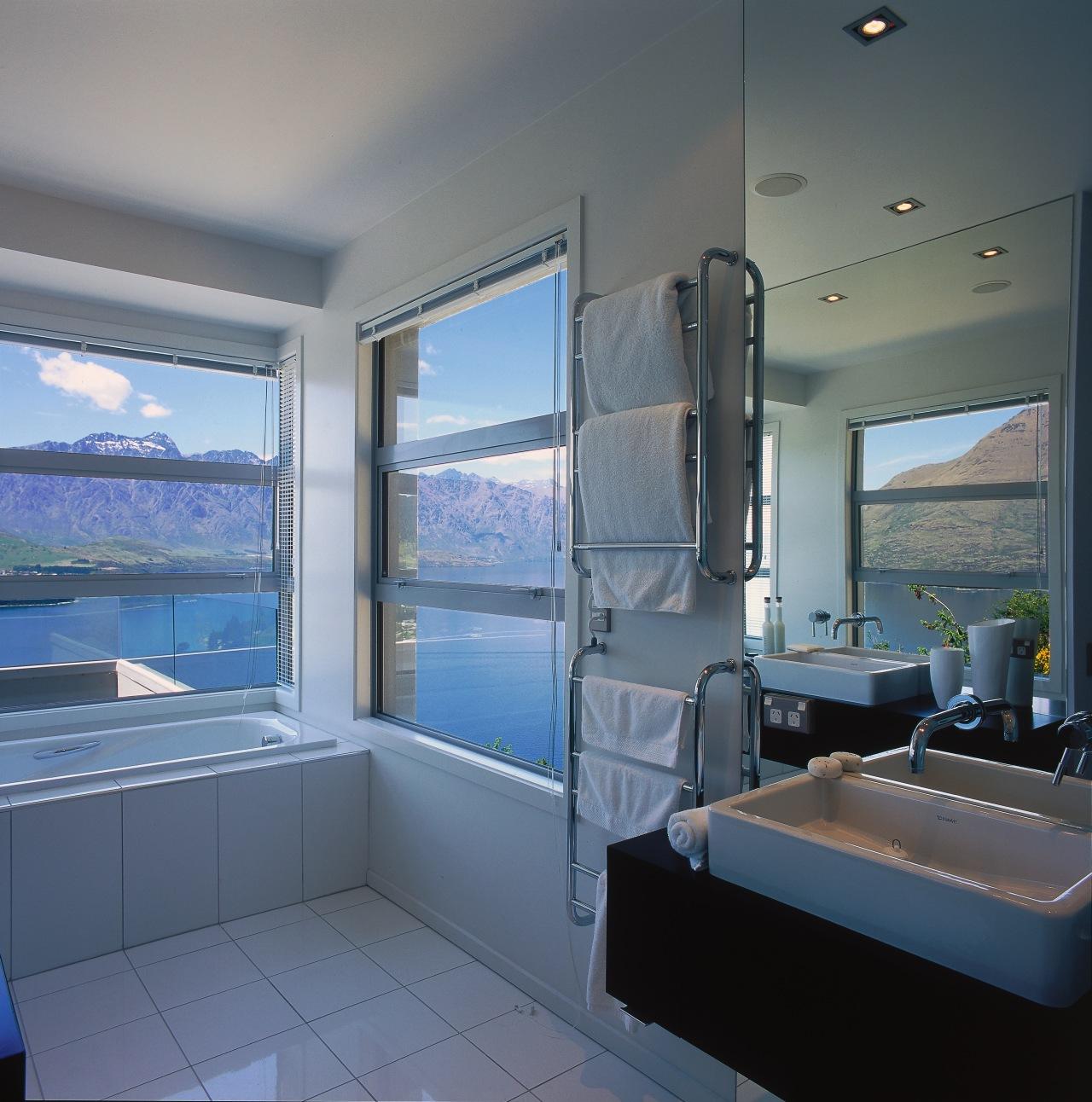 A view of a bathroom, wooden vanity, white bathroom, interior design, real estate, room, window, gray
