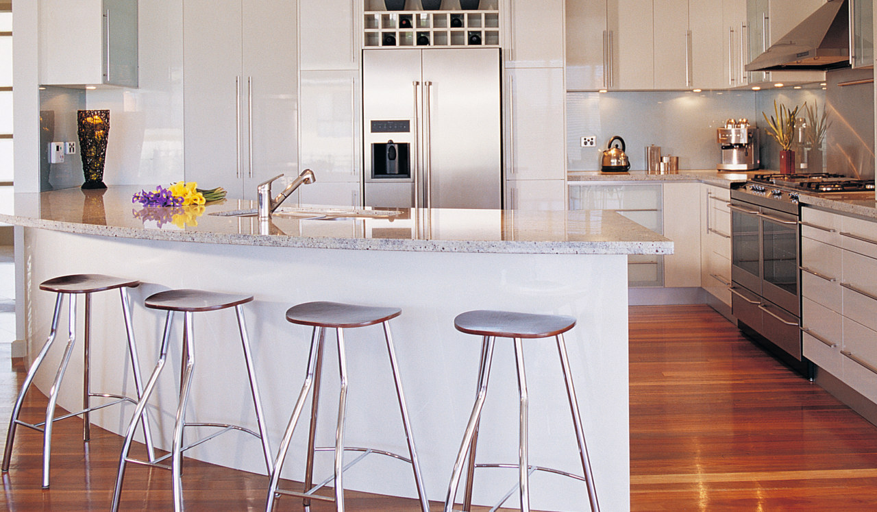 Kitchen with light coloured cabinetry, granite benchtop, curved cabinetry, countertop, cuisine classique, floor, flooring, furniture, hardwood, interior design, kitchen, laminate flooring, room, table, wood flooring, gray, white