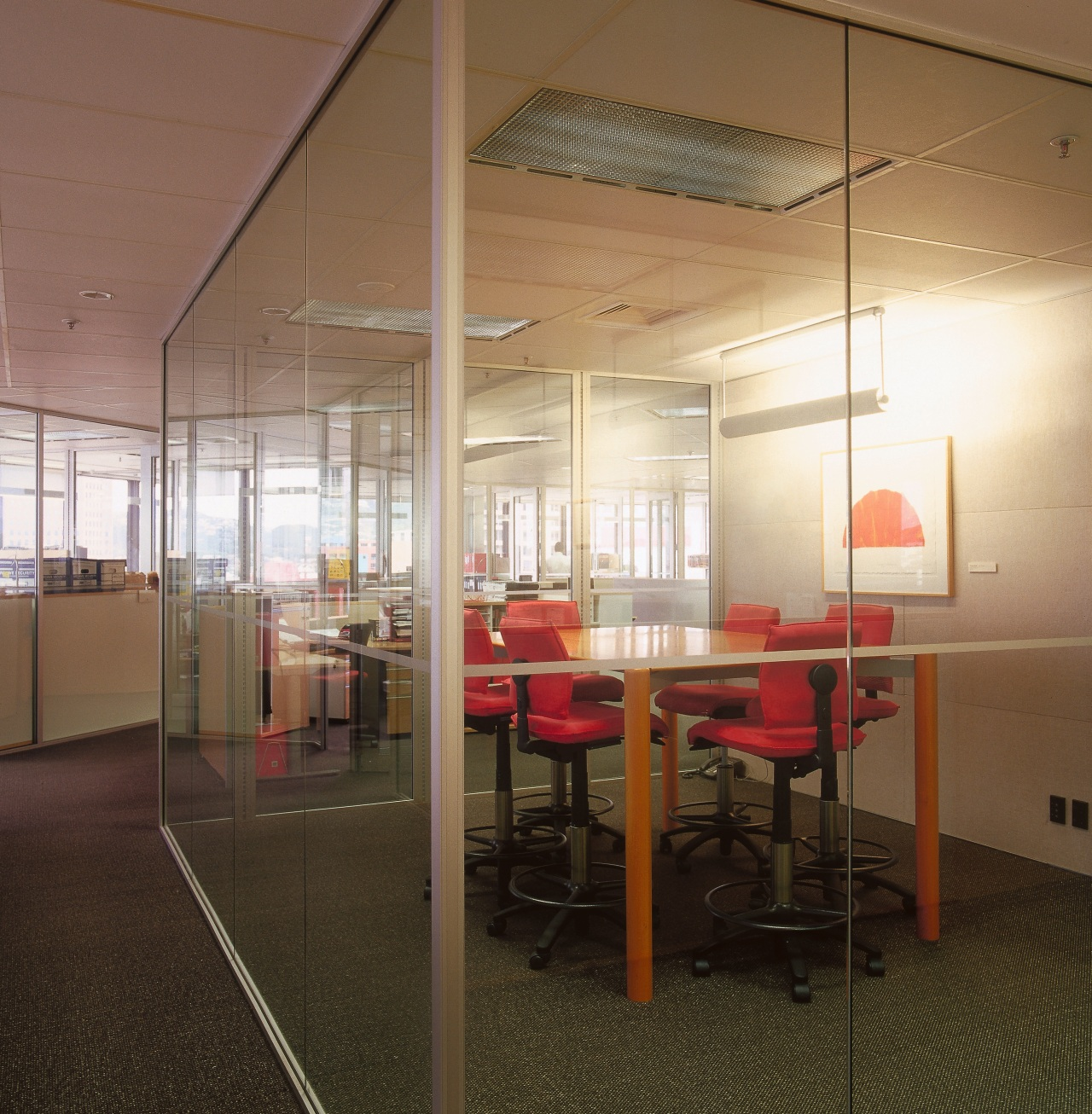 A view of the offices, glass screens, desks architecture, ceiling, daylighting, floor, flooring, interior design, office, table, wall, brown