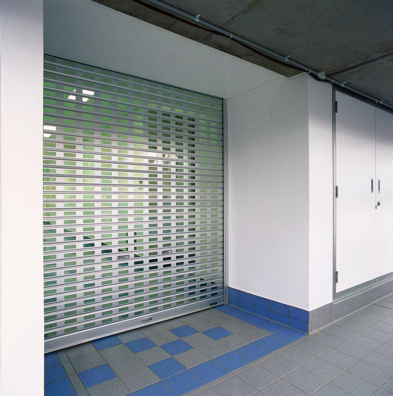 View of slotted aluminium roller shutter door. architecture, daylighting, glass, wall, gray, white