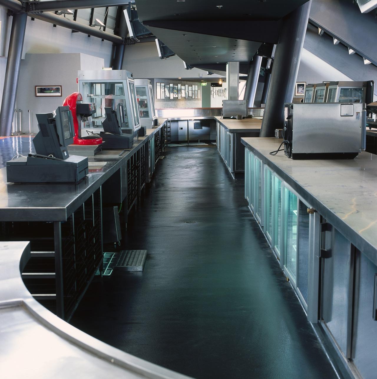 Bar and kitchen hospitality area featuring vinyl flooring. floor, black, gray