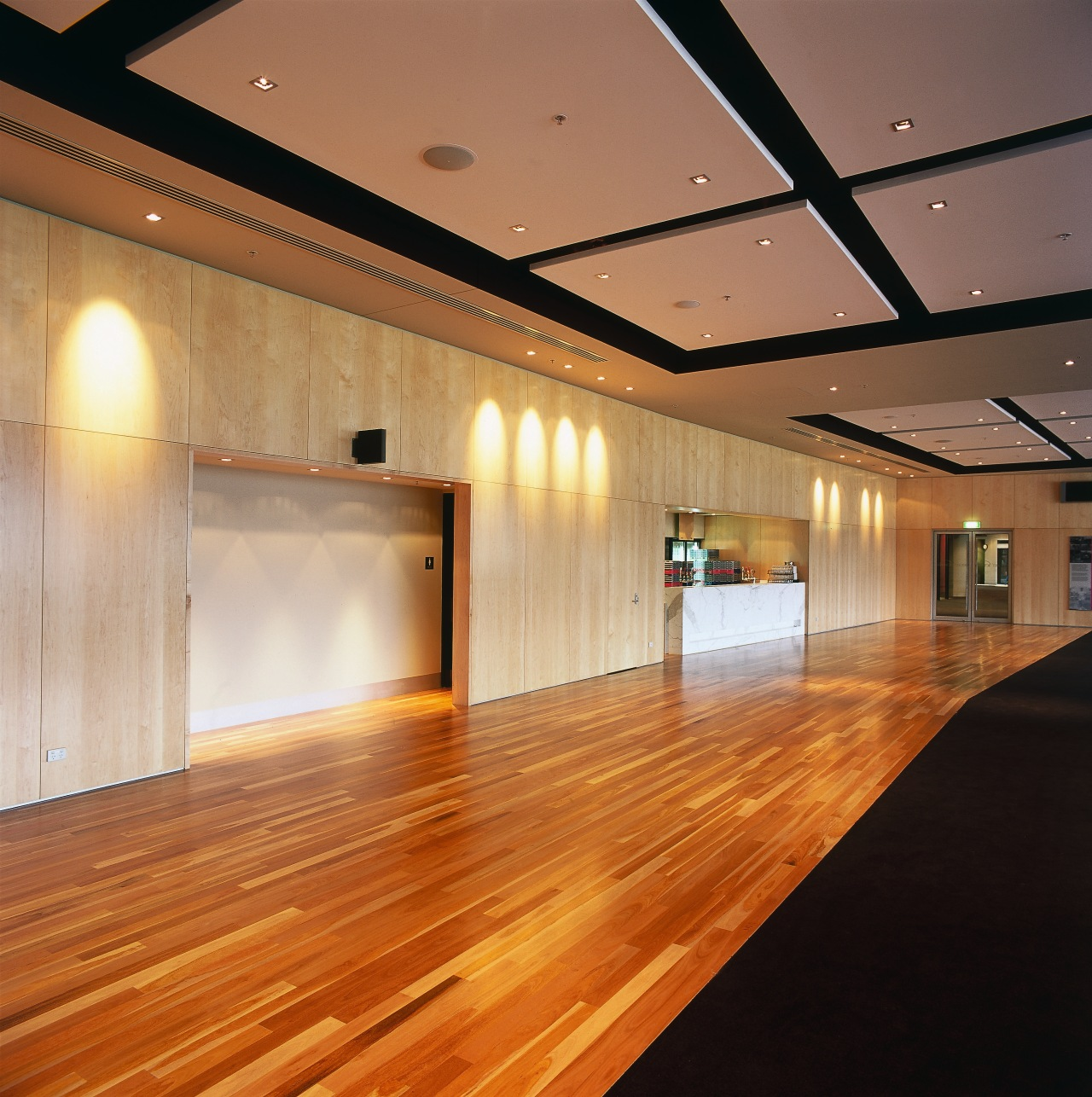Large function room with maple walll panelling and architecture, ceiling, daylighting, floor, flooring, function hall, hardwood, interior design, laminate flooring, light, lighting, lobby, wood, wood flooring, brown, orange
